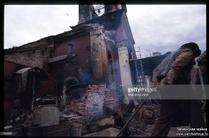 A Chechen civilian walks amid ruins January, 1995 in Grozny, Russia
