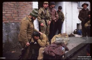 A Chechen fighter consoles a comrade January 13, 1995 in Russia - копия
