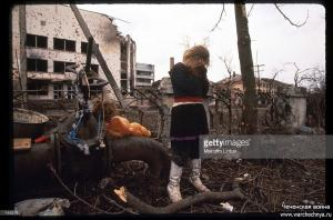 A Chechen girl stands amid ruins January, 1995 in Grozny, Russia