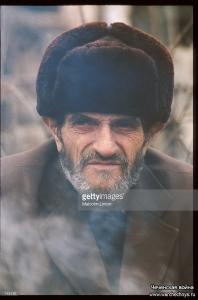 A Chechen man stands January, 1995 in Russia