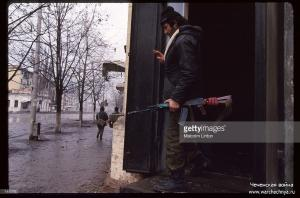 A Chechen soldier stands with a gun January, 1995 in Grozny, Russia