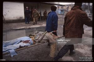 Chechen fighters carry a wounded comrade January 13, 1995 in Russia1