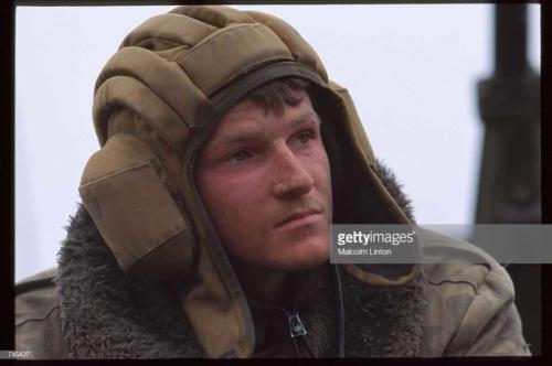A Russian interior ministry soldier sits January, 1995 near Grozny, Russia