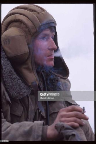 A Russian soldier smokes a cigarette January, 1995 near Grozny, Russia