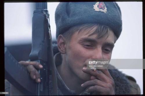 A Russian soldier smokes a cigarette January, 1995 near Grozny, Russia2