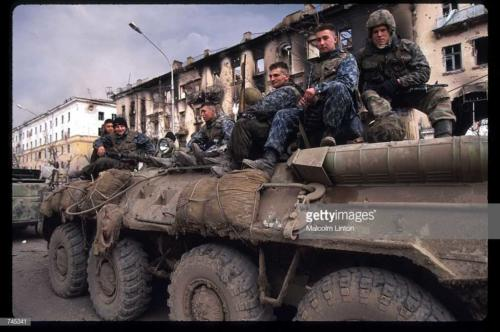 A group of Russian soldiers sit on an armored personnel carrier February 11, 1995 in Grozny, Russia