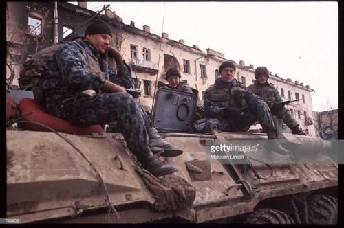A group of Russian soldiers sit on an armored personnel carrier February 11, 1995 in Grozny, Russia2