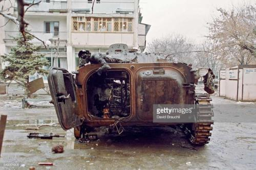 Civil war victim on an armored car in Grozny