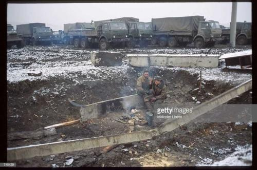 Russian interior ministry soldiers sit in the snow January, 1995 near Grozny, Russia2