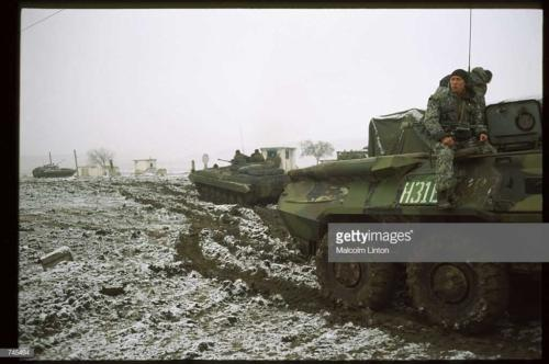 Russian interior ministry soldiers sit on armored personnel carriers January 10, 1995 near Grozny, Russia