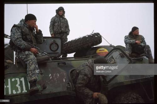 Russian interior ministry soldiers sit on top of an armored personnel carrier January, 1995 near Grozny, Russia2