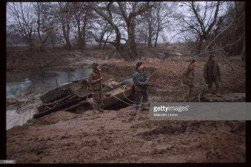 Russian interior ministry soldiers stand in the mud January, 1995 near Grozny, Russia