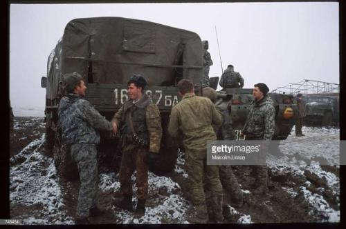 Russian interior ministry soldiers stand in the snow January, 1995 near Grozny, Russia