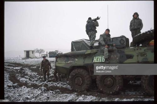 Russian interior ministry soldiers stand on an armored personnel carrier January, 1995 near Grozny Russia