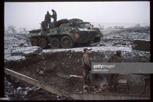 Russian interior ministry soldiers stand on an armored personnel carrier January, 1995 near Grozny Russia2