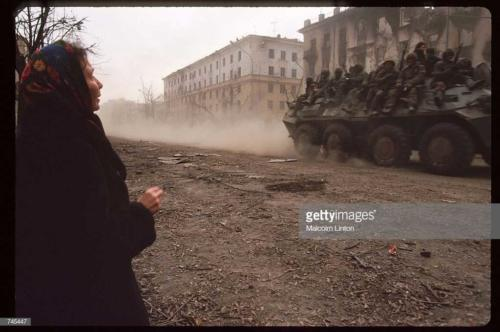 Russian soldiers ride on top of an armored personnel carrier January, 1995 in Grozny, Russia