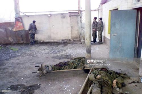 Two of the three bodies of the russians soldiers shown by Chechen commanders to the foreign press