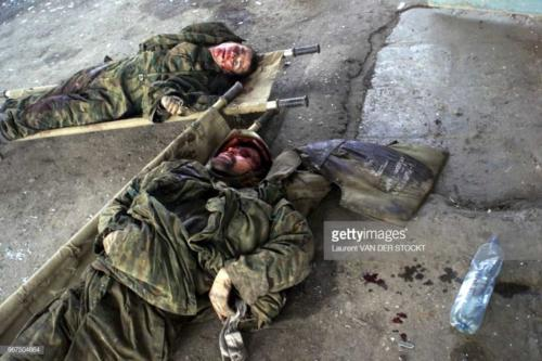 Two of the three bodies of the russians soldiers shown by Chechen commanders to the foreign press2