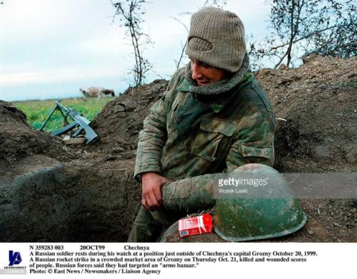 2 A Russian Soldier Rests During His Watch At A Position Just Outside Of Chechnya's Capital Grozny October 20, 1999