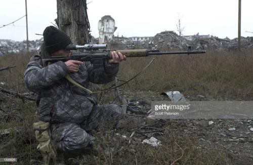 2 A Russian sniper takes aim in central Grozny November 23, 2000, capital of the breakaway republic of Chechnya