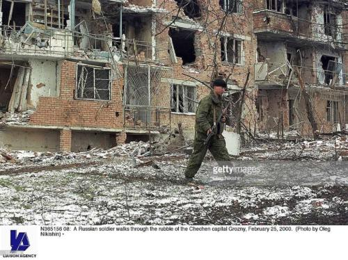 2 A Russian soldier walks through the rubble of the Chechen capital Grozny, February 25, 2000