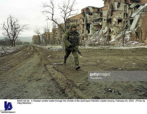 2 A Russian soldier walks through the streets of the destroyed Chechen capital Grozny, February 25, 2000
