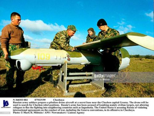 2 Russian army soldiers prepare a pilotless drone aircraft at a secret base near the Chechen capital Grozny. The drone will be used to search for Chechen rebel positions