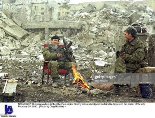 2  Russian soldiers in the Chechen capital Grozny man a checkpoint on Minutka Square in the center of the city, February 25, 2000