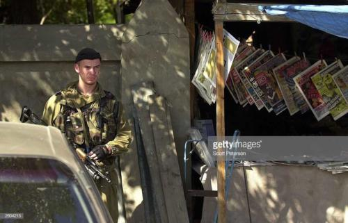 2  Russian soldiers patrol in Grozny, Chechnya October 6, 2003, the day after elections confirmed Moscow's choice of Akhmad Kadyrov as president of the Chechen republic3
