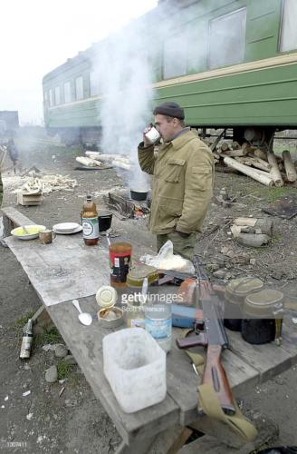 2  Russian troops eat a bleak breakfast November 22, 2000 at Russia''s main military base at Khankala, 10 miles east of the Chechen capital, Grozny