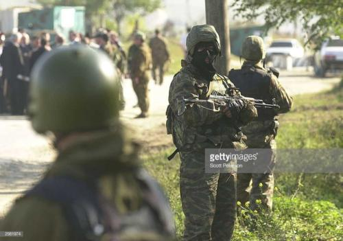 2  Russian troops provide security for Chechens voting to elect a new president October 5, 2003 in Tsenderoi, Chechnya, Russia