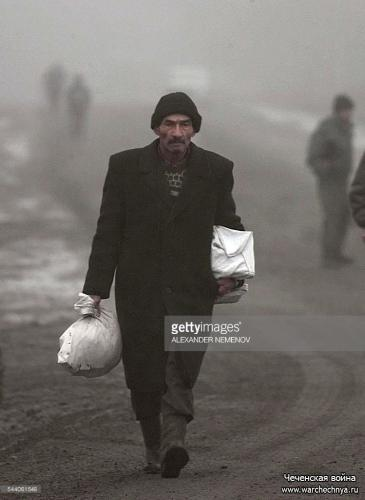 A Chechen refugee is on his way to Ingushetia 27 December 1999, near the Chechen-Ingush check point