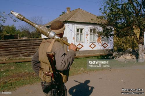A Chechen soldier patrols the streets of Noja-Iourt during the Second Chechen War. Location Noja-Iourt, Chechnya