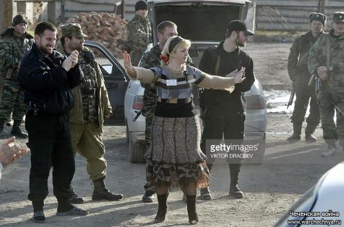 A Chechen woman dances during the vote for the new Chechen Parliament outside a polling station in Grozny in Chechnya, 27 November 2005