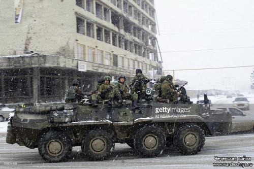 A Russian Army armored personnel carrier (APC) patrols a street in Grozny 17 January 2006