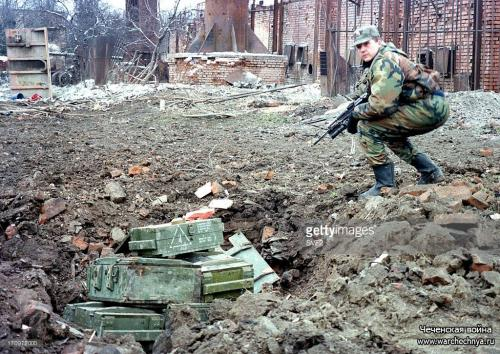 A russian sapper prepares to destroy mines and shells found at house wreckages in the chechen capital of grozchechnya, russia, march 2, 2000